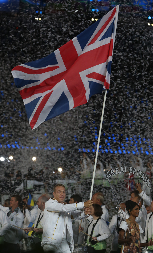 Sir Chris Hoy holds the Union Jack as he lead the GB team into the Stadium for the London Olympic Games 2012 Opening Ceremony