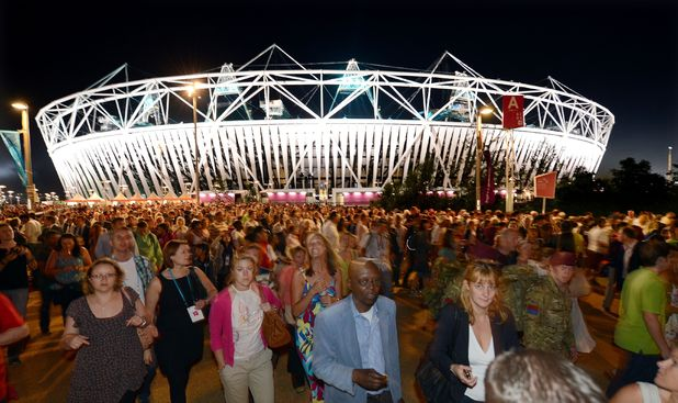 London 2012: Crowds leave the Olympic Stadium following a technical rehearsal for the opening ceremony
