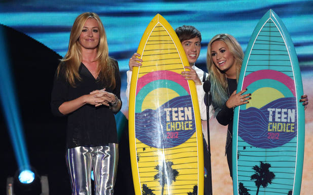 Cat Deeley presents Choice TV Comedy award to GLEE and Kevin McHale, and Choice Summer Music Star Female Demi Lovato.