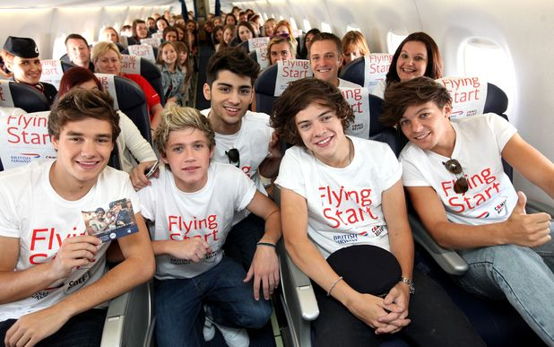 One Drection join fans on a British Airways flight between London and Manchester as part of a competition in which they raised £50,000 for Flying Start, the global charity partnership between British Airways and Comic Relief