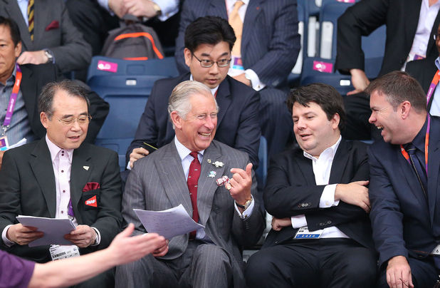 The Prince of Wales watches the Women's badminton.
