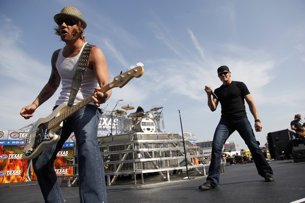 3 Doors Down' Todd Harrell, left, and singer Brad Arnold, right, perform before the NASCAR Samsung Mobile 500 auto race at Texas Motor Speedway Saturday
