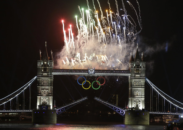 Fireworks explode above the iconic Tower Bridge over the River Thames during the Opening Ceremony.
