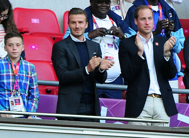 David Beckham and Prince William watch the Olympic football.