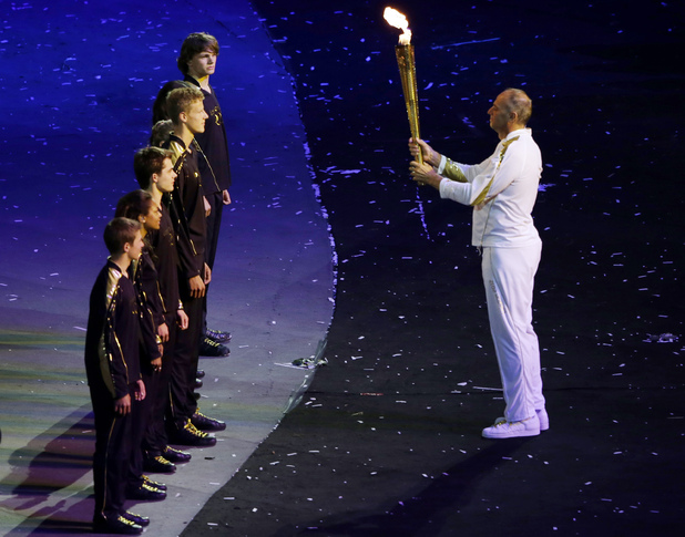 Sir Steve Redgrave prepares to hand the torch over to the chosen young Olympians.