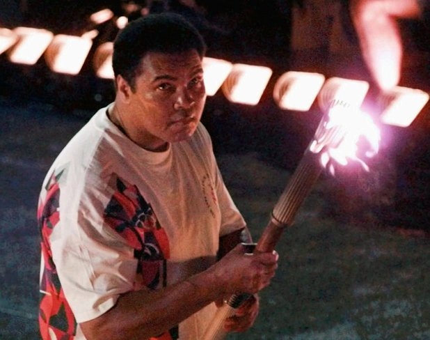 Muhammad Ali lights the Olympic flame in Atlanta - July 19, 1996 (PA green label)
