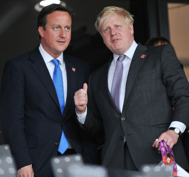 David Cameron and London Mayor Boris Johnson watch the ceremony.