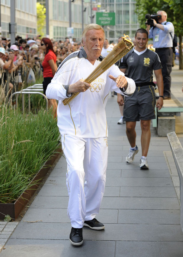 Bruce Forsyth with Olympic Torch