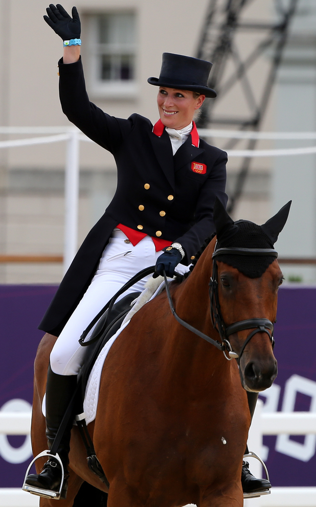 Zara Phillips waves on High Kingdom after the Dressage stage of the Eventing at Greenwich Park.