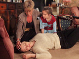 Ken, Deirdre and Amy return to find Tracy unconscious on the floor