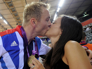 Sir Chris Hoy kisses his wife Sarra as they celebrate his gold medal win at the Velodrome