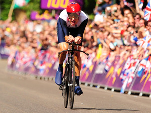 Great Britain's Bradley Wiggins races towards the finish line during the Men's Individual Time Trial on day five of the London Olympic Games at Hampton Court Palace