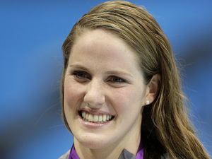United States&#39; Missy Franklin poses with her gold medal after her win in the women&#39;s 200-meter freestyle swimming semifinal at the Aquatics Centre in the Olympic Park during the 2012 Summer Olympics in London, Monday, July 30, 2012.