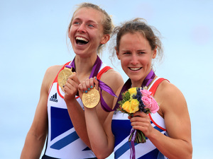 Great Britain's Sophie Hosking and Katherine Copeland celebrate winning gold in the final of the lightweight women's double sculls.
