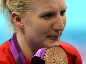 Great Britain&#39;s Rebecca Adlington cries after the medal ceremony for the Women&#39;s 800m Freestyle at the Aquatics Centre in the Olympic Park, London, on the seventh day of the London 2012 Olympics.