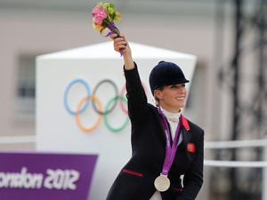Great Britain&#39;s Zara Phillips after receiving her silver medal on day four of the London Olympic Games at Greenwich Park, London.