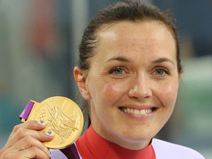 Great Britain&#39;s Victoria Pendleton celebrates with her Gold medal after winning the Women&#39;s Keirin Final at the Velodrome in the Olympic Park, during day seven of the London 2012 Olympics.