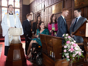 At Joseph's christening, Owen confronts Gary about his visit to Carter's surgery