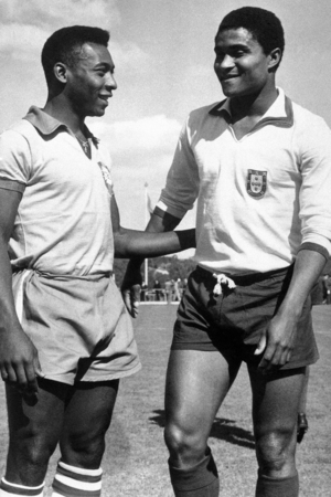 Brazilian footballer Edson Arantes do Nascimento, known as Pele, left, enjoys a chat on a football pitch with Eusebio da Silva Ferreira in Lisbon, Portugal on April 27, 1963.
