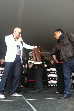 Pitbull is presented with a Walmart care package during a personal appearance in Kodiak, Alaska
