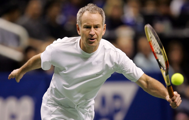 John McEnroe returns a serve as he played doubles with Sweden's Jonas Bjorkman during the quarterfinals of the SAP Open tennis tournament in San Jose, Calif., on Friday, Feb. 17, 2006.