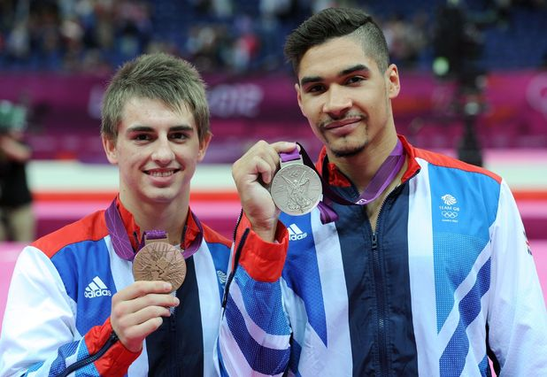 Max Whitlock and Louis Smith celebrate with their medals after the Men's Pommel Horse Final.