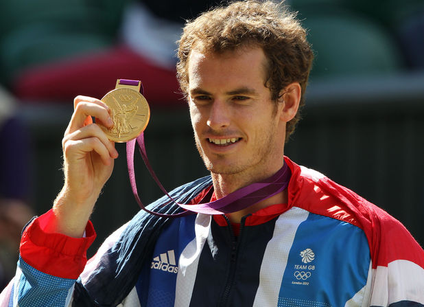 Andy Murray with his gold medal after beating Switzerland&#39;s Roger Federer in the final at Wimbledon, London.