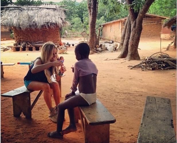 The Bachelorette star Emily Maynard plays with a child on her humanitarian trip to Ghana