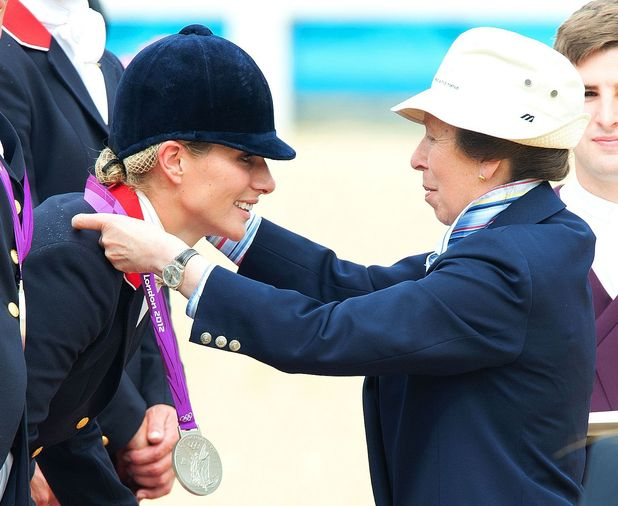Zara Phillips is presented with her silver medal by her mother Princess Anne, who she greeted with a kiss on each cheek