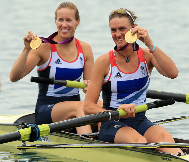 Great Britain's Helen Glover (left) and Heather Stanning celebrate winning gold in the women's pair final at Eton Dorney Lake