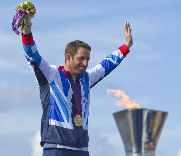 Ben Ainslie celebrates winning his fourth Olympic gold medal.
