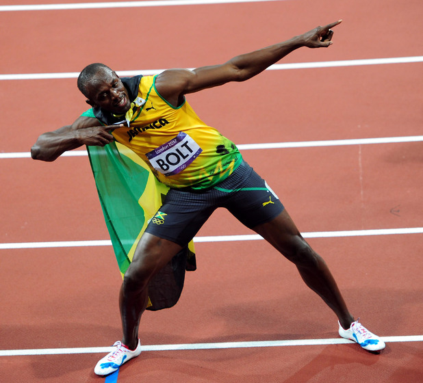 Jamaica's Usain Bolt celebrates winning the men's 100m final.