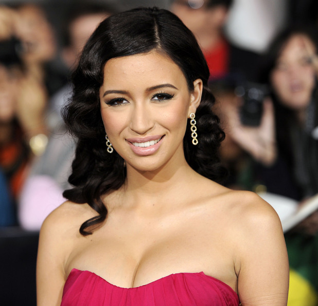 "Christian Serratos arrives at the world premiere of ""The Twilight Saga: Breaking Dawn - Part 1"" in November 2011"
