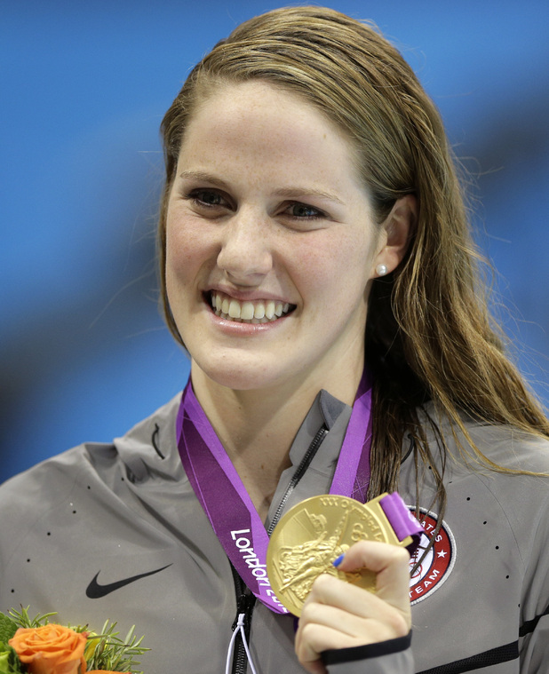 United States' Missy Franklin poses with her gold medal after her win in the women's 200-meter freestyle swimming semifinal at the Aquatics Centre in the Olympic Park during the 2012 Summer Olympics in London, Monday, July 30, 2012.