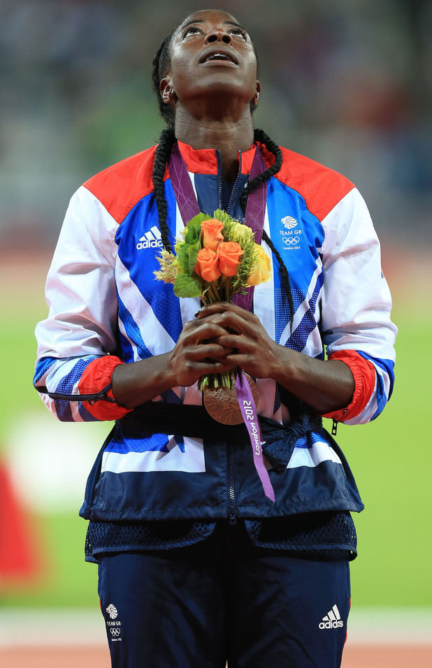 An emotional Christine Ohuruogu receives her silver medal after the 400m final at the Olympic Stadium, London.
