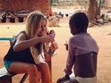 Jef Holm posts a photograph of Emily Maynard playing with a child in Ghana.