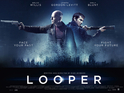 Willis and Gordon-Levitt point guns in the new dark poster for Looper.