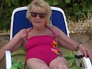 "Nanny Pat ""lives the dream"" on a sun lounger"