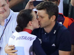 Victoria Pendleton, kisses her fiance Scott Gardner after winning the Gold medal in the Women's Keirin