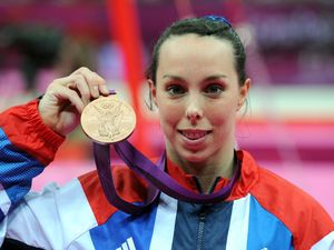 Beth Tweddle celebrates with her Bronze medal after the Women&#39;s Uneven Bars Final