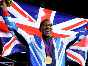 Anthony Joshua celebrates with his Gold medal following his Super Heavy Weight Final against Italy's Roberto Cammarelle.