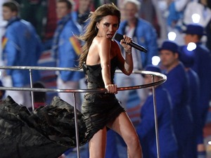 Victoria Beckham of the the British pop group Spice Girls performs during the Closing Ceremony at the 2012 Summer Olympics, Sunday, Aug. 12, 2012, in London. (AP Photo/Martin Meissner)