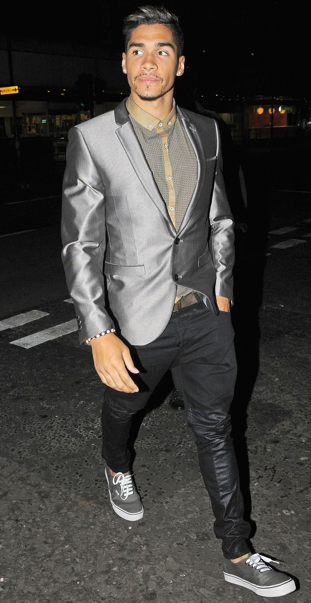 Gymnast Louis Smith leaves The Rose Club in London.
