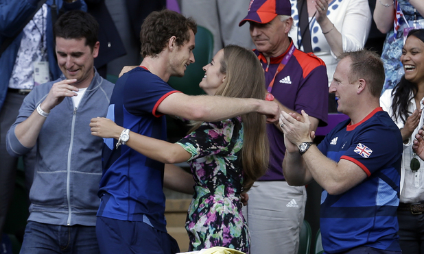 Andy Murray hugs his girlfriend Kim Sears reacts after defeating Switzerland's Roger Federer to win the men's singles gold medal match (August 5)
