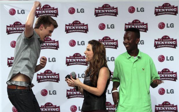Austin Wierschke, left, reacts after winning the 2012 LG U.S. National Texting Championship