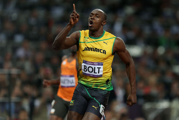 Usain Bolt crossing the line in the 100m final at the London 2012 Olympic games (PA green label)
