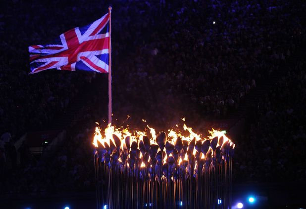 London 2012 Olympics Closing Ceremony: The Union flag flies above the Olympic flame.