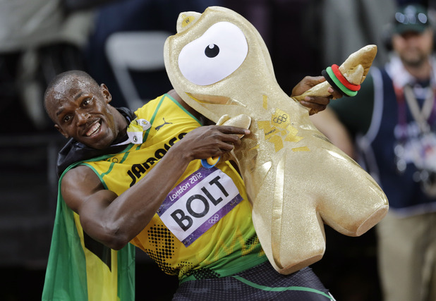 Jamaica's Usain Bolt celebrates winning gold in the men's 100-meter final