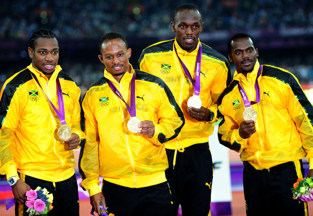 Jamaica's 4x100m relay team celebrate their gold medal: Usain Bolt's third of this Olympic competition.