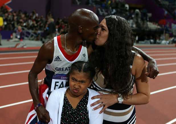 Olympic athletes celebrate with a kiss 